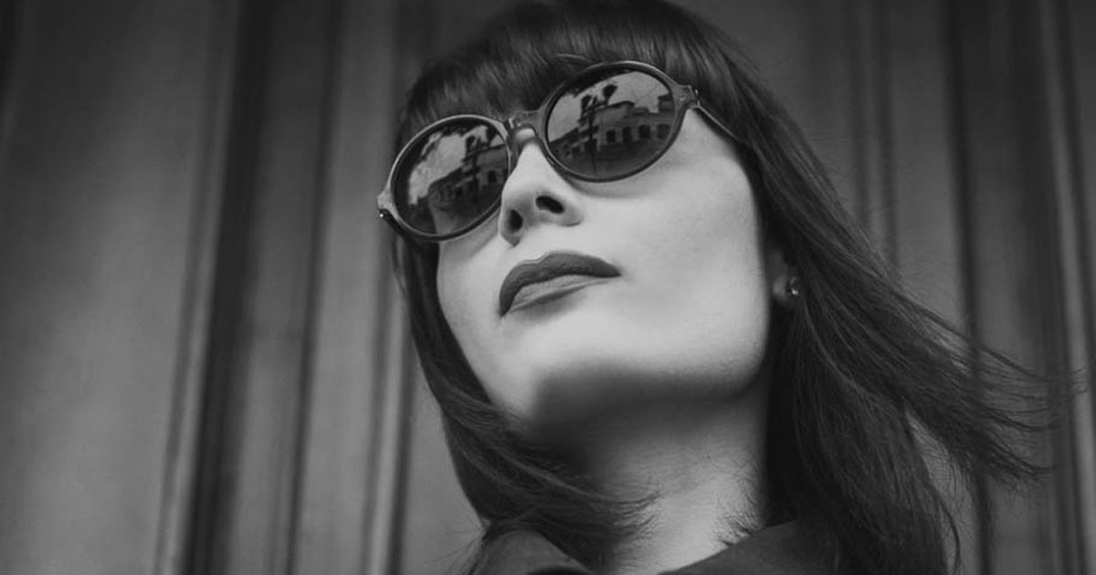 Under shot of a bold woman in sunglasses