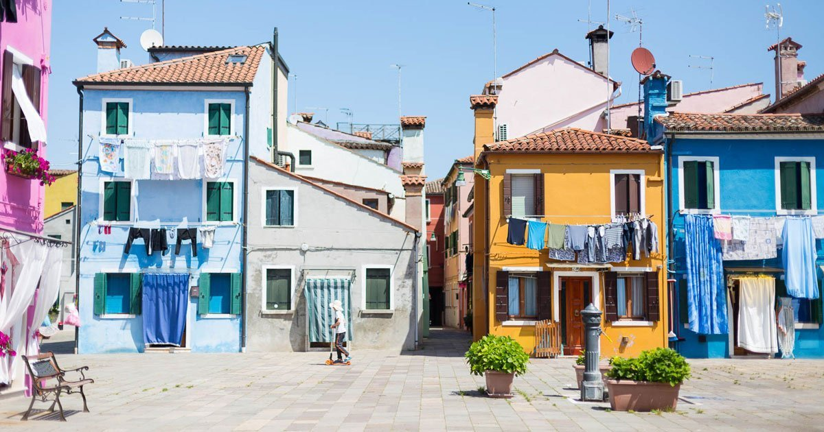 bright buildings and laundry lines in Burano, Italy