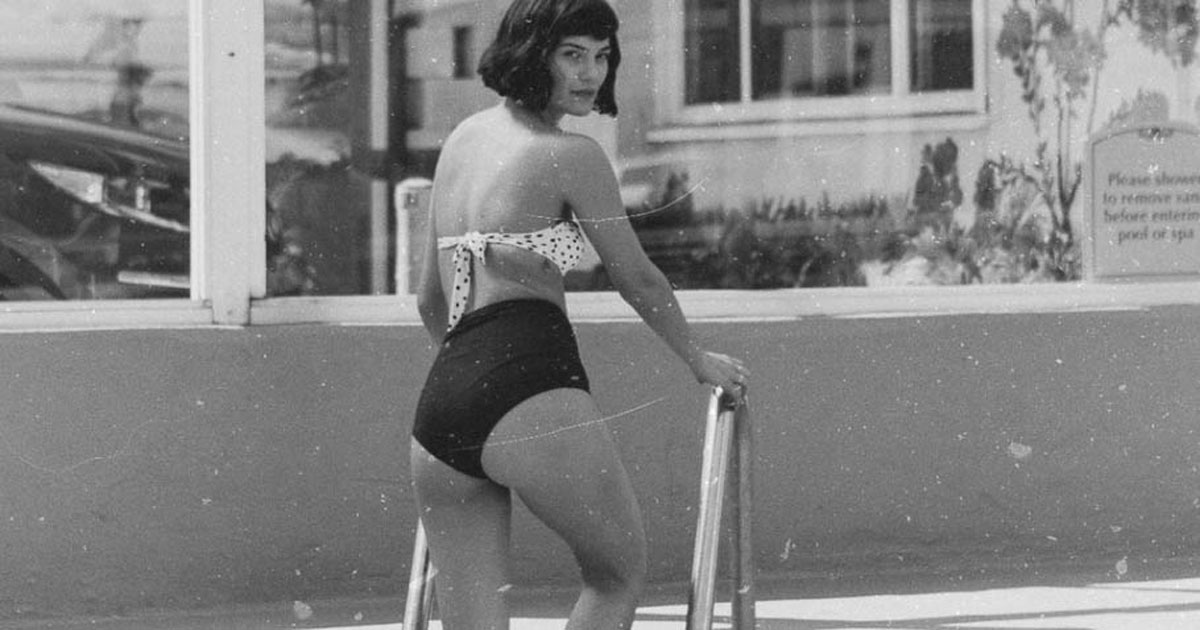 woman in a swimsuit getting out of a pool