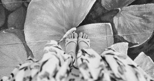 overhead view of skirt and feet with sandals